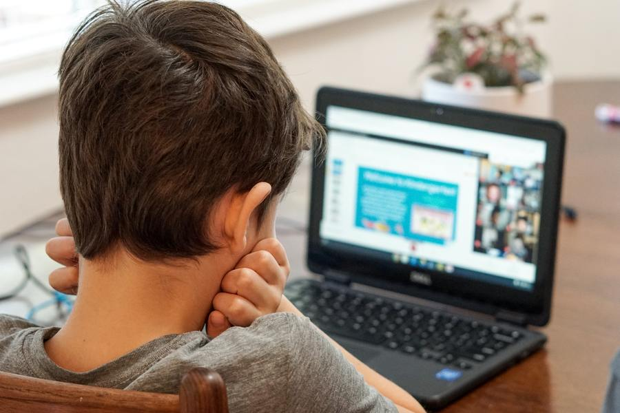 Boy attending back to school online, hosted by Therachat